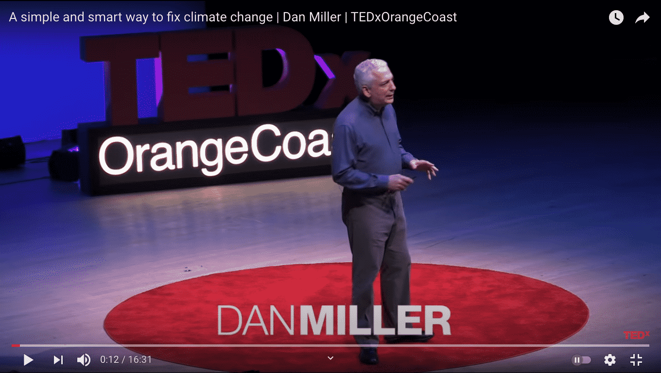 Dan Miller on stage during his TEDx Talk on carbon fee and carbon dividend